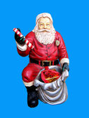Figure of Santa Claus isolated on blue — Stock Photo