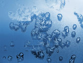 Frost icy flowers on a glass — Stock Photo