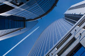 Flying airplane and office buildings — Stok fotoğraf