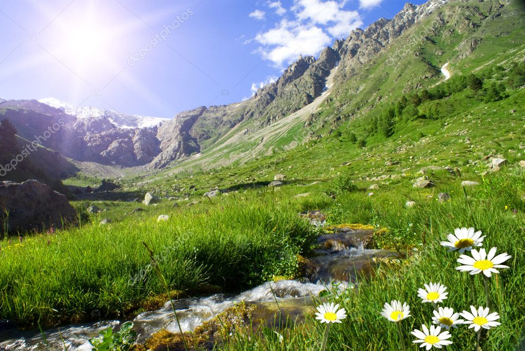 Mountain landscape with the small river, sun and colors  Stock Photo #1095515