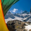 Kind on mountains from a tent — Stock Photo