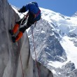 Ice-climber goes down downward on an ice — Stock Photo