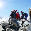 Group of climbers on the top of mountain - Stock Photo