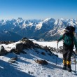 Mountaineer rises uphill - Stock Photo