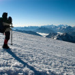 Mountaineer takes pictures — Stock Photo
