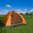 Tourist yellow tent on green lawn — Stock Photo #1192626