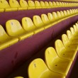 Yellow seats on stadium - Stock Photo