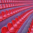Red seats on stadium - Stock Photo