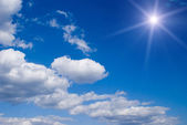 Sun on dark blue sky — Stock Photo
