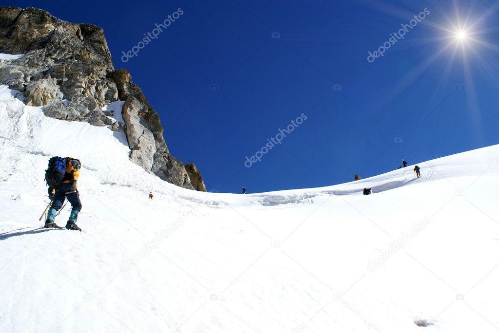 Group of climbers goes out on the top of mountain — Stock Photo #1191876
