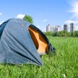 Tourist tent on a background town houses — Stock Photo