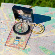 Compass and map — Stock Photo