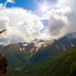 Girl on a background mountain valley — Stock Photo