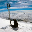 Ski poles and backpack cost on to snow - Stock Photo