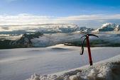 Ice-axe, stuck in snow — Stock Photo