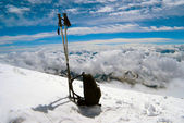 Ski poles and backpack cost on to snow — Stock Photo