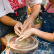 Potter teaches to the handicraft - Stok fotoğraf