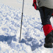 Feet of alpinist of going uphill — Stock Photo