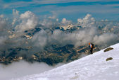 An alpinist coasts downward — Stock Photo