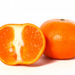Ripe mandarin and half — Stock Photo