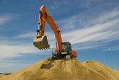 Excavator at the building site — Stock Photo