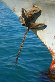 Rusty anchor and chain — Stock Photo