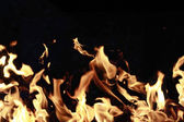 Fire isolated on black — Stock Photo