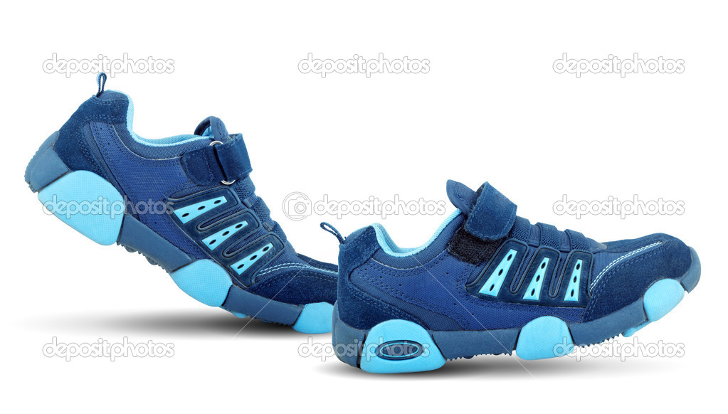 Sneakers walking by themselves isolated on white background — Stock Photo #1105087