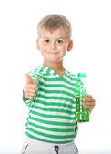 Boy drinking water — Stock Photo