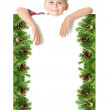 Royalty-Free Stock Photo: Boy  holding a christmas banner