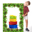 Boy  holding a christmas banner — Stock Photo