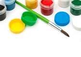 Paints with a paintbrush — Stock Photo