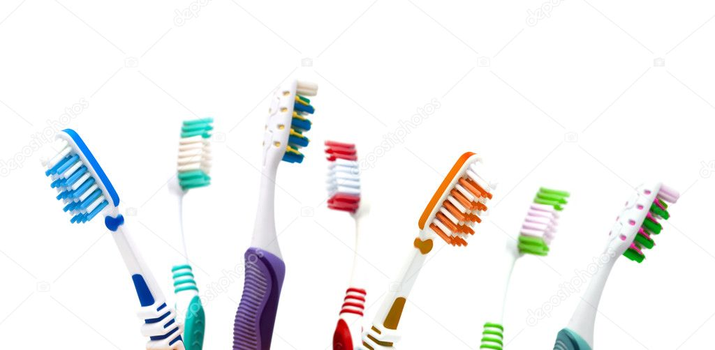 Colorfull toothbrushes  in a cup isolated on white background — Stock Photo #1642240