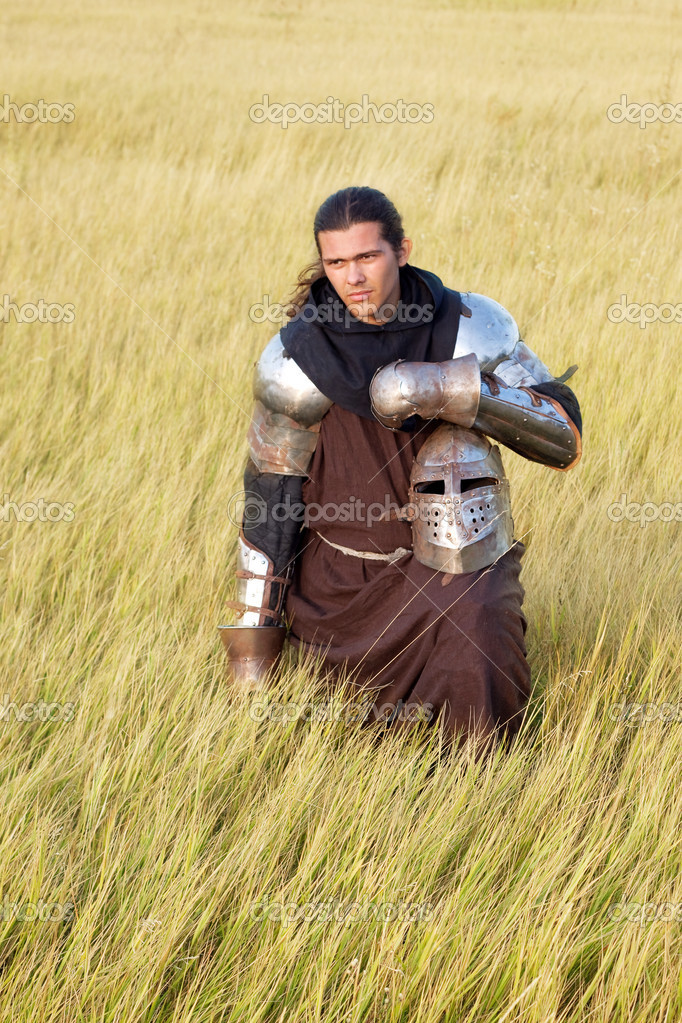 Medieval knight in the field with a helmet — Stock Photo #2339331