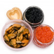 Stock Photo: Red and black caviar in a heart