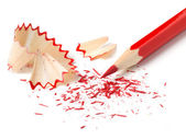 Red pencil and chips on white background (isolated). — Stock Photo