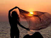 Girl on sunset background. — Stock Photo