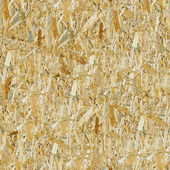Pressed wooden panel seamless background — Stock Photo