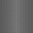 Stock Photo: Perforated metal seamless background.