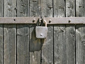 Padlock on fence. — Stock Photo