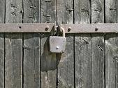 Padlock on fence. — Stock Photo