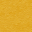 Stock Photo: Yellow leather seamless background.