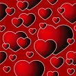 Red hearts seamless background. — Imagen vectorial