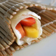Stock Photo: Rolled pancake with fruits