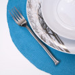 Plates and fork served on a placemat — Stock Photo