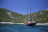 Yacht in a mediterranan bay — Stock Photo