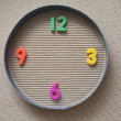 Toy clock made from magnetic digits — Stock Photo