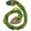 图库照片: Green handmade weaved beads
