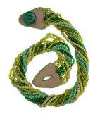 Green handmade weaved beads — Stock Photo