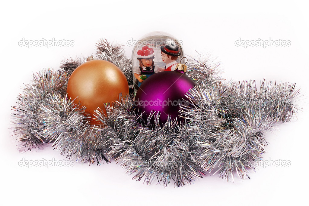 Gold and purple globes on tinsel background with a toy Santa Claus, snowflake and  snow globe  — Stock Photo #1152772
